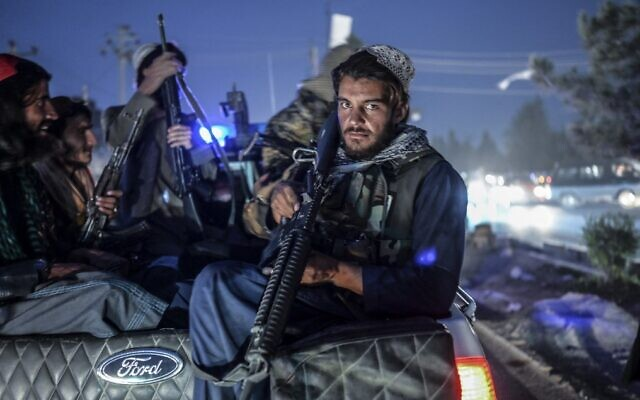 Members of the Taliban patrol on a pickup truck in Kabul, on September 30, 2021. (Bulent Kilic/AFP)