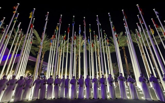 Emirati men line up to welcome visitors the opening ceremony of the Dubai Expo 2020, on September 30, 2021. (Giuseppe Cacace/AFP)