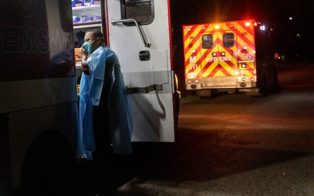 An EMS medic from the Houston Fire Department prepares to transport a COVID-19 patient to a hospital, on August 24, 2021, in Houston, Texas. (John Moore/Getty Images/AFP)