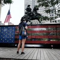 People visit a monument made of dog tags of fallen US troops from the Global War on Terror at Liberty Park on the World Trade Center campus in New York City, August 31, 2021. (Spencer Platt/Getty Images/AFP)