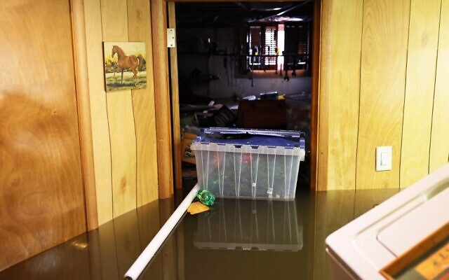 Personal belongings are seen floating in the flooded basement of a home on Hayward Place on September 02, 2021 in Passaic City. (Michael M. Santiago/Getty Images/AFP)
