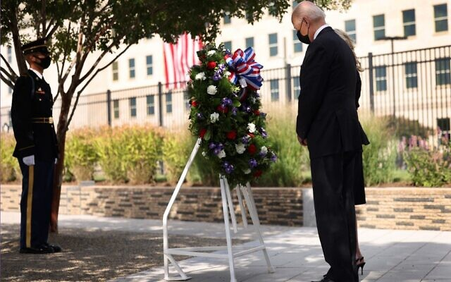 US President Joe Biden and First Lady Jill Biden attend a wreath-laying ceremony at the National 9/11 Pentagon Memorial, on September 11, 2021, in Arlington, Virginia. (Kevin Dietsch/Getty Images North America/Getty Images via AFP)