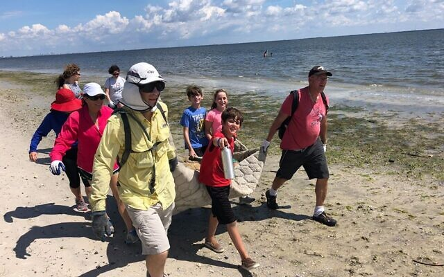 Volunteers pick trash off the beach at the first-ever Reverse Tashlich event in 2018. (Courtesy/ Bob Fryer)