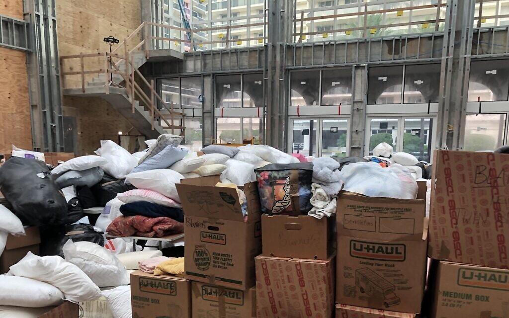 A social hall under construction in The Shul, a synagogue in Surfside, Florida, is piled high with donations for homeless families less than 18 hours after a nearby building collapsed, June 25, 2021. (Ron Kampeas/ JTA)