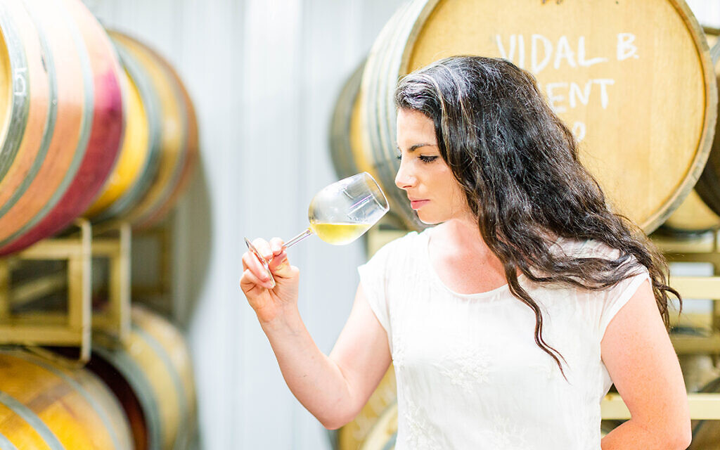Rachel Lipman, at 28 perhaps the youngest winemaker in Maryland, is pushing through boundaries in a traditionally male-dominated industry. (Jonna Michelle Photography/ via JTA)