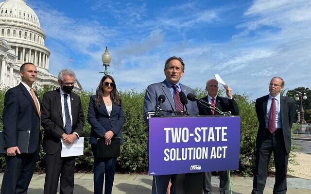 """Rep. Andy Levin speaks at a press conference introducing his """"Two-State Solution Act"""" on Capitol Hill, Sept. 23, 2021. He is flanked by, from left: Hadar Susskind, the president and CEO of Americans for Peace Now; Rep. Alan Lowenthal; Rep. Sara Jacobs; Rep. Peter Welch; and J Street President Jeremy Ben-Ami. (Ron Kampeas/JTA)"""