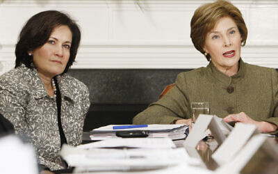 Anita McBride, left, Chief of Staff to first lady Laura Bush, right, looks on as Mrs. Bush makes opening remarks during a video teleconference in the Roosevelt Room of the White House in Washington, Monday, Dec. 10, 2007. (AP Photo/Charles Dharapak)