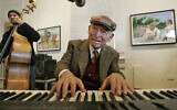 George Wein plays with a jazz band in New Orleans at the New Orleans Jazz & Heritage Festival, December 16, 2008. (AP Photo, File)