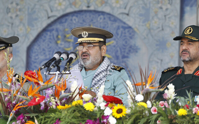 Then-chief of the General Staff of Iran's Armed Forces, General Hasan Firouzabadi, center, delivers a speech, as Revolutionary Guard commander Mohammad Ali Jafari, right, and army commander Ataollah Salehi, listen, during armed forces parade marking the 31st anniversary of the start of the Iraq-Iran War, in front of the mausoleum of the late Iranian revolutionary founder Ayatollah Khomeini, just outside Tehran, Iran, September 22, 2011. (AP Photo/Vahid Salemi)