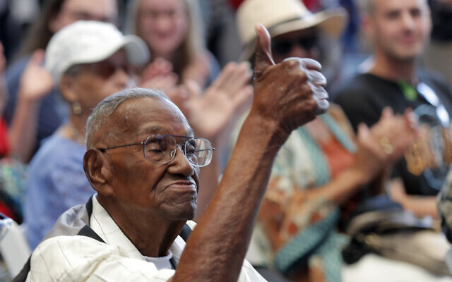 World War II veteran Lawrence Brooks acknowledges the crowd as he celebrates his 110th birthday at the National World War II Museum in New Orleans, September 12, 2019. (AP Photo/ Gerald Herbert)