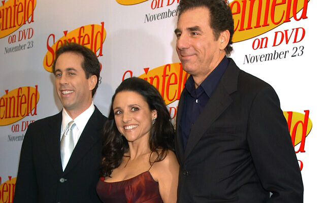 In this November 17, 2004, file photo Jerry Seinfeld, left, Julia Louis Dreyfus and Michael Richards arrive to celebrate the release of the first three seasons of Seinfeld on DVD in New York. (AP/ Louis Lanzano, File)