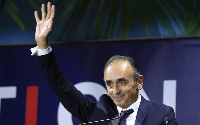 French writer, politician and journalist Eric Zemmour acknowledges applauses after his speech at the Convention of the Right, in Paris, September 28, 2019. (AP Photo/Michel Euler)
