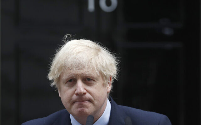 British Prime Minister Boris Johnson making a statement on his first day back at work in Downing Street, London, after recovering from a bout with the coronavirus that put him in intensive care, April 27, 2020. (AP Photo/Frank Augstein, FILE)