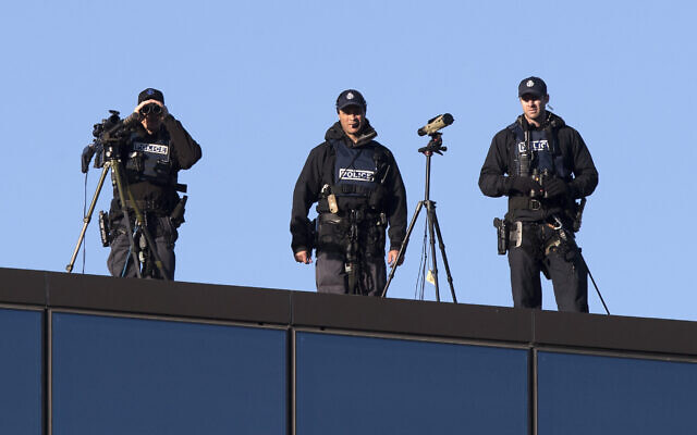 Illustrative: Police marksmen watch from the rooftop of the Christchurch High Court ahead of day two of the sentencing hearing of Australian Brenton Harrison Tarrant, in Christchurch, New Zealand, August 25, 2020. (AP Photo/Mark Baker)