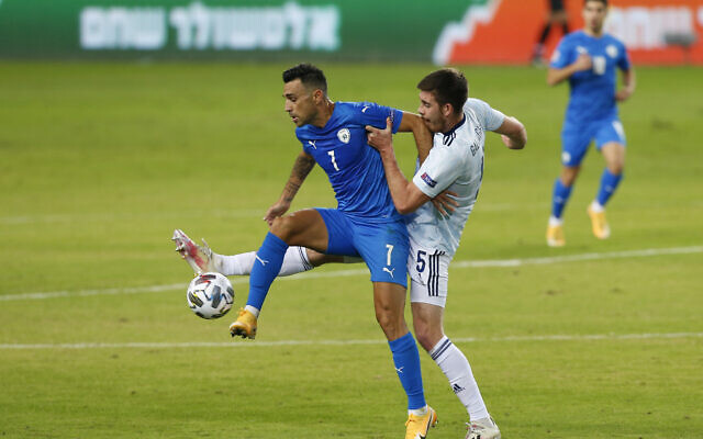 Illustrative: Eran Zahavi, left, and Scotland's Declan Gallagher fight for the ball during the UEFA Nations League soccer match between Israel and Scotland in Netanya, Israel, Wednesday, Nov. 18, 2020. (AP Photo/Ariel Schalit)