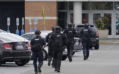 Illustrative -- Police officers jog toward an entrance at the Westfield Southcenter Mall after the shopping center was evacuated following a reported shooting, May 1, 2021, in Tukwila, Washington, south of Seattle. (AP Photo/Ted S. Warren)