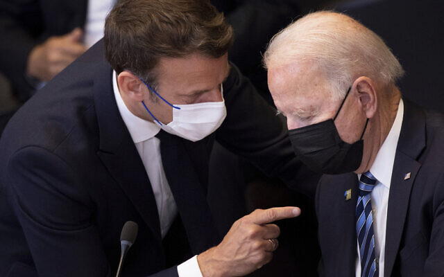 US President Joe Biden, right, speaks with French President Emmanuel Macron during a plenary session during a NATO summit at NATO headquarters in Brussels, June 14, 2021. (Brendan Smialowski, Pool via AP)