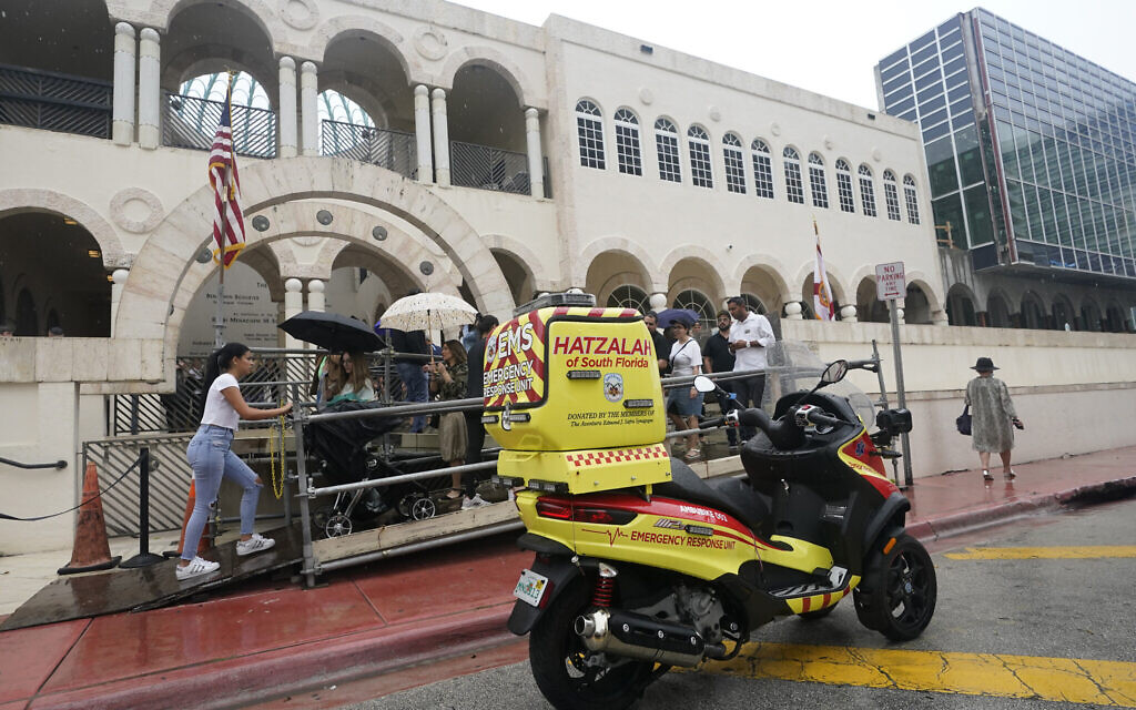 An ambucycle belonging to Hatzalah of South Florida, a volunteer emergency medical service organization serving mostly areas with Jewish communities, is shown parked outside The Shul of Bal Harbour, a Jewish community center in Surfside, Florida, June 14, 2021. (AP Photo/Wilfredo Lee)
