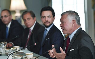 Jordanian King Abdullah II, right, as Jordan's Crown Prince Hussein, second right, looks on, speaks to Secretary of State Antony Blinken, Tuesday, July 20, 2021 at the State Department in Washington. (Nicholas Kamm /Pool via AP)