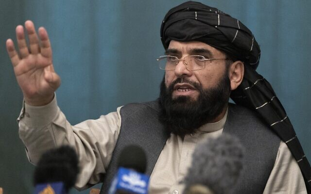 In this March 19, 2021 file photo, Suhail Shaheen, Afghan Taliban spokesman gestures while speaking during a joint news conference in Moscow, Russia.  (AP Photo/Alexander Zemlianichenko, Pool, File)