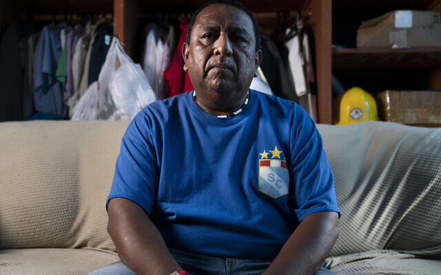 Franklin Anchahua-Herrera sits for a portrait in a room that he shares with his father, August 17, 2021, in the Queens borough of New York. (AP/John Minchillo)