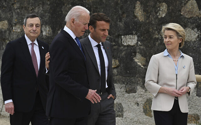 In this Friday, June 11, 2021 file photo, from left, Italian Prime Minister Mario Draghi, U. President Joe Biden, French President Emmanuel Macron and European Commission President Ursula von der Leyen walk together during the G7 Summit, in Carbis Bay, Cornwall, England.  (Leon Neal/Pool Photo via AP, File)