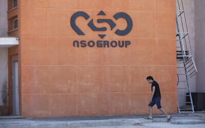A logo adorns a wall on a branch of the Israeli NSO Group company, near the southern Israeli town of Sapir, August 24, 2021. (AP/Sebastian Scheiner)