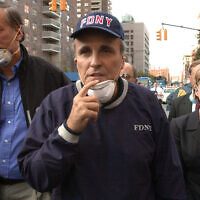 In this Wednesday, Sept. 12, 2001 file photo, New York City Mayor Rudolph Giuliani, center, leads New York Gov. George Pataki, left, and Sen. Hillary Clinton, D-N.Y., on a tour of the site of the World Trade Center disaster (AP Photo/Robert F. Bukaty, File)