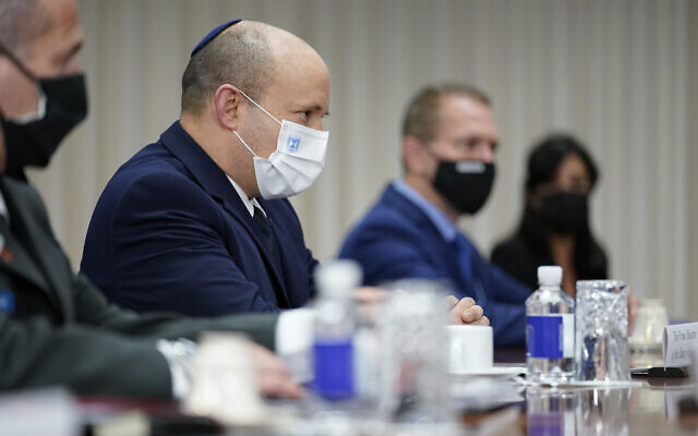Prime Minister Naftali Bennett is seated for a meeting with US Secretary of Defense Lloyd Austin at the Pentagon in Washington, on August 25, 2021. (AP Photo/Andrew Harnik)