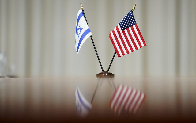 A flag of Israel and an American flag are displayed on a table during a meeting between Secretary of Defense Lloyd Austin and Israeli Prime Minister Naftali Bennett at the Pentagon in Washington, Wednesday, Aug. 25, 2021. (AP Photo/Andrew Harnik)
