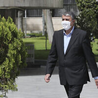 In this photo released by the official website of the office of the Iranian Presidency, Mohammad Eslami, walks in the presidency compound, April 7, 2021, in Tehran, Iran (Iranian Presidency Office via AP)