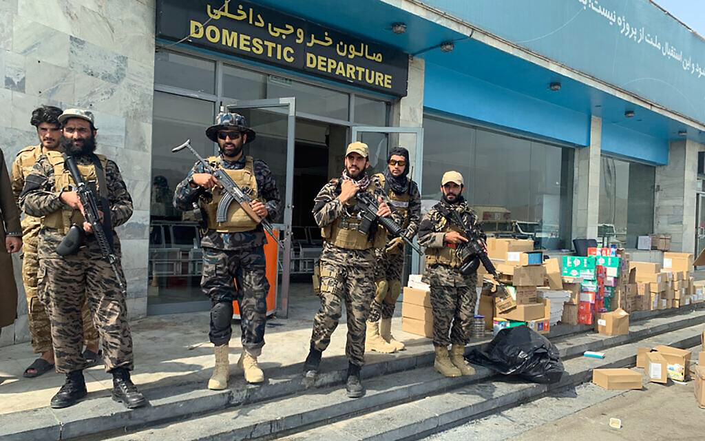 Taliban fighters stand guard inside the Hamid Karzai International Airport after the US withdrawal in Kabul, Afghanistan, August 31, 2021. (AP Photo/Kathy Gannon)