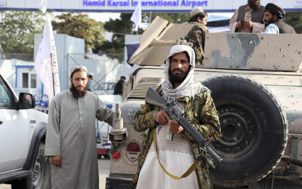 Taliban fighters stand guard in front of the Hamid Karzai International Airport after the US withdrawal in Kabul, Afghanistan, August 31, 2021. (AP Photo/Khwaja Tawfiq Sediqi)