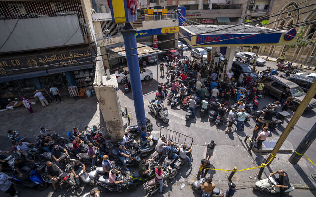 Motorcycle drivers wait to get fuel at a gas station in Beirut, Lebanon,  August 31, 2021. (Hassan Ammar/AP)