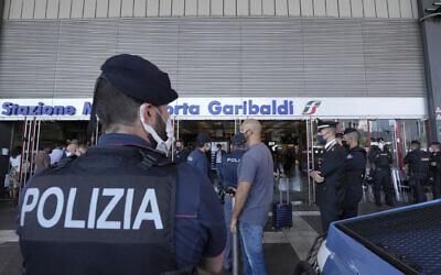 Illustrative: Italian police officers stand guard at Porta Garibaldi train station, in Milan, Italy, September 2, 2021. (Luca Bruno/AP)