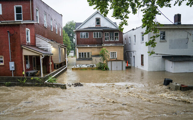 Water floods a street September 1, 2021, in Bridgeville, Pennsylvania. (Andrew Rush/Pittsburgh Post-Gazette via AP)