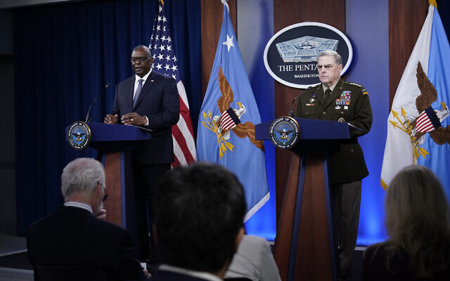 US Secretary of Defense Lloyd Austin (left) answers a question during a briefing with US Joint Chiefs of Staff Gen. Mark Milley (right) at the Pentagon in Washington, on Wednesday, September 1, 2021, about the end of the war in Afghanistan. (AP Photo/Susan Walsh)