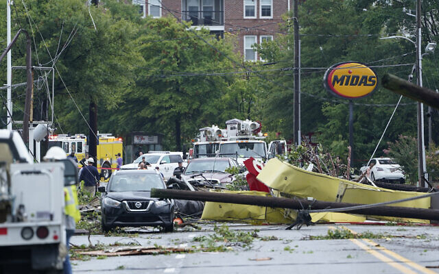 Debris is strewn along West Street in Annapolis, Maryland, September 1, 2021, after severe weather moved through the area. (AP Photo/Susan Walsh)