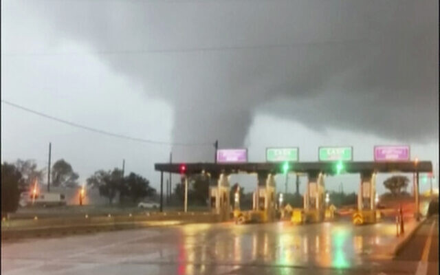 A fast-moving tornado is seen in the distance through a windshield just before the toll booth for the Burlington Bristol Bridge on September 1, 2021, in Burlington, New Jersey. (Scott Smith via AP)