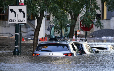 Vehicles are under water during flooding in Philadelphia, on Thursday, September 2, 2021, in the aftermath of downpours and high winds from the remnants of Hurricane Ida that hit the area. (AP Photo/Matt Rourke)