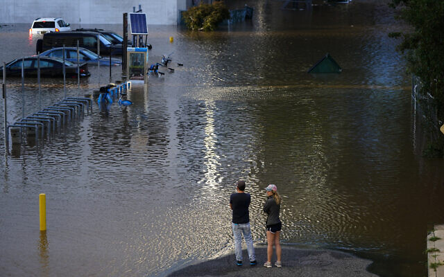 People view a flooded street in Philadelphia, on Thursday, September 2, 2021, in the aftermath of downpours and high winds from the remnants of Hurricane Ida that hit the area. (AP Photo/Matt Rourke)