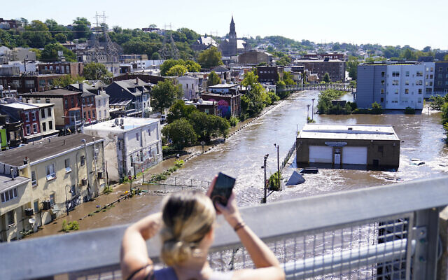 The Schuylkill River exceeds its bank in the Manayunk section of Philadelphia, on Thursday, September 2, 2021, in the aftermath of downpours and high winds from the remnants of Hurricane Ida that hit the area. (AP Photo/Matt Rourke)