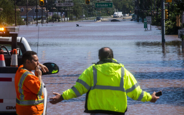 People take a look at the 206 route partially flooded  as a result of the remnants of Hurricane Ida in Somerville, N.J., Thursday, Sept. 2, 2021. (AP/Eduardo Munoz Alvarez)