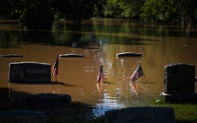 Headstones at a cemetery that flooded in Somerville, N.J. September 2, 2021. (AP Photo/Eduardo Munoz Alvarez)