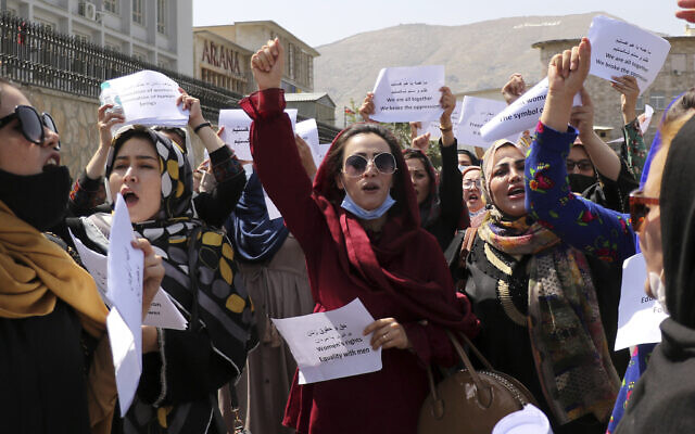 Women gather to demand their rights under the Taliban rule during a protest in Kabul, Afghanistan, Friday, Sept. 3, 2021. (AP Photo/Wali Sabawoon)