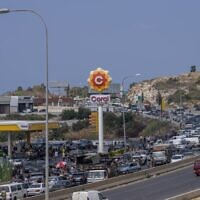 A general view of a petrol station on the main highway that links the Capital Beirut to south Lebanon as cars come from every direction to try and fill their tanks with gasoline, in the coastal town of Jiyeh, south of Beirut, Lebanon, Friday, Sept. 3, 2021 (AP Photo/ Hassan Ammar)