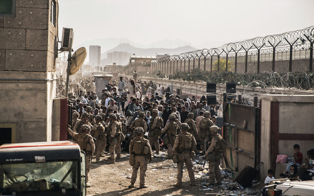 In this August 21, 2021,file photo provided by the US Marines, US Marines with Special Purpose Marine Air-Ground Task Force - Crisis Response - Central Command, provide assistance at an evacuation control checkpoint during an evacuation at Hamid Karzai International Airport in Kabul, Afghanistan. (Staff Sgt. Victor Mancilla/US Marine Corps via AP, File)