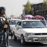 A Taliban fighter stand guards in the city of Kabul, Afghanistan, September 4, 2021. (AP/Wali Sabawoon)
