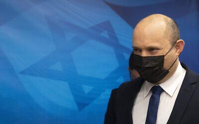 Prime Minister Naftali Bennett arrives for the weekly cabinet meeting at the Prime Minister's office in Jerusalem, on September 5, 2021. (AP Photo/Sebastian Scheiner, Pool)