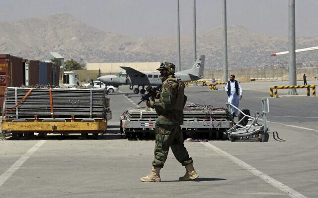 A Taliban soldier walks on the tarmac at Hamid Karzai International Airport in Kabul, Afghanistan, September 5, 2021.  (AP Photo/Wali Sabawoon)